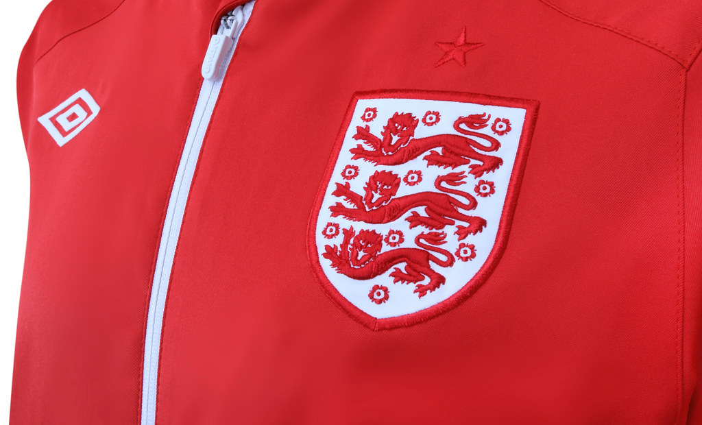 4c43b7349 Now England kit provider Umbro has released detailed pictures of the England  Umbro 2010/12 Away Anthem Jacket. This retro-look top will be worn by  captain ...