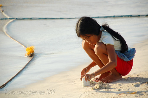 Playing in the sand, Calaguas Island, Camarines Norte