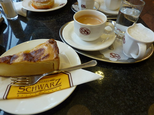 picture shows coffee service and a slice of cake
