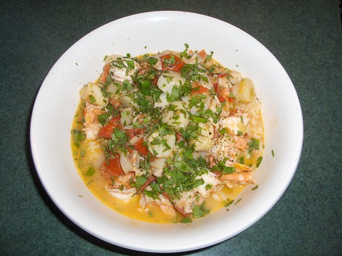 Seafood in saffron broth, with rice