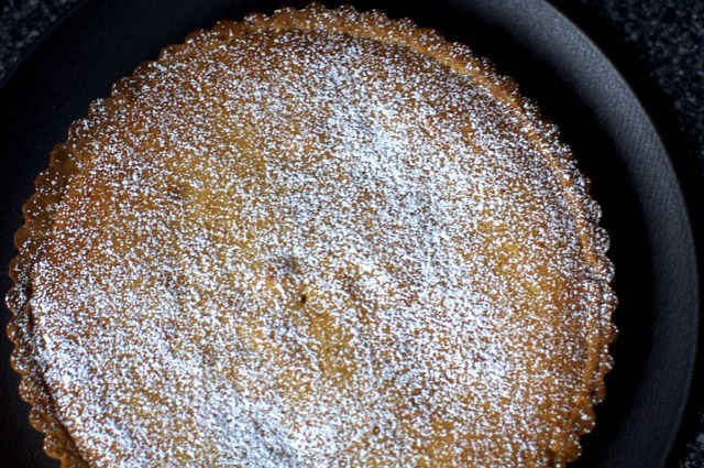 bakewell tart, dusted with sugar