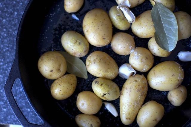 potatoes, garlic and bay, ready to roast