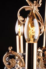 The incandescent light bulb in golden chandelier