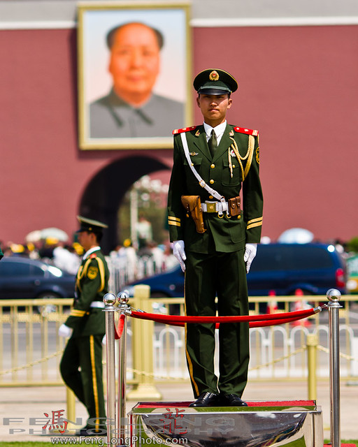 Chinese solider in front of Mao Zedong's portrait