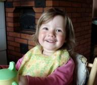 Joyful child eating
