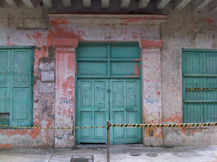 Weathered and worn down buildings await renovation throughout the city.
