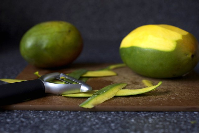 peeling the mangoes