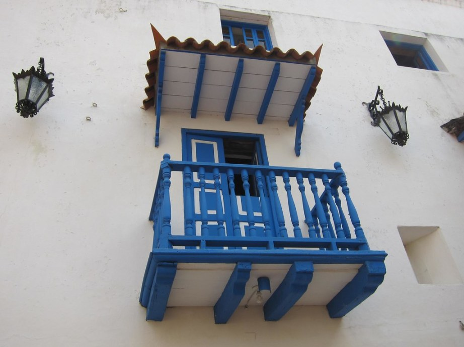 Balconies and hanging lamps are common on the building facades in the old city center.