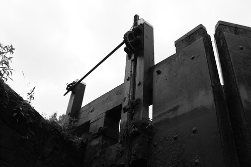 Canal lock gate, with paddle open indicated by a raised winding mechanism