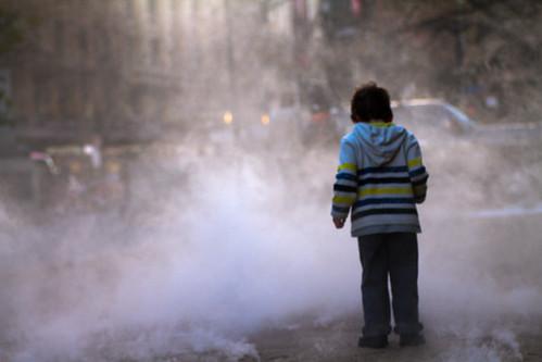A boy enjoying the adventure through the misty fog