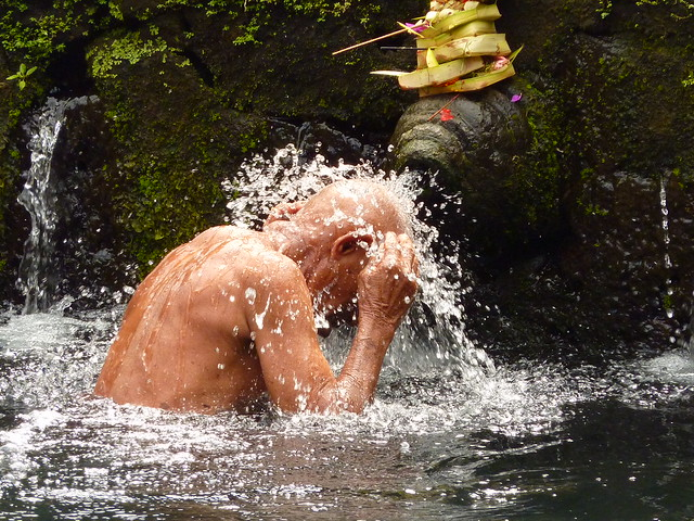 Old man bathing at Tirta Empul