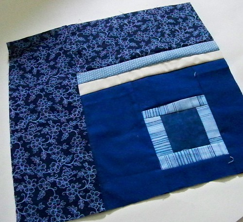Dark blue improv patchwork quilt block for rainbow around the block