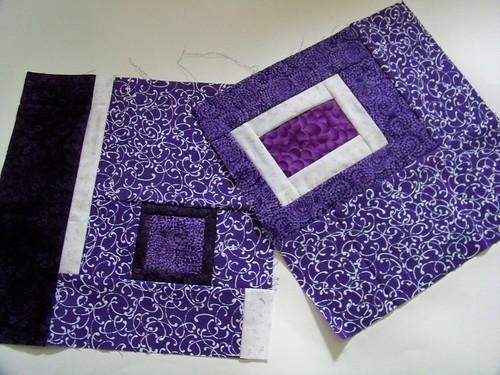 Purple improvisational quilt blocks for rainbow around the block