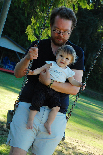 Swinging with daddy.