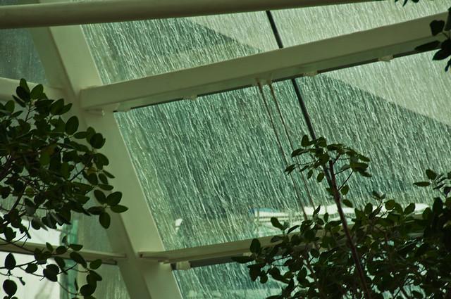 Rain on the sloping windows of the atrium