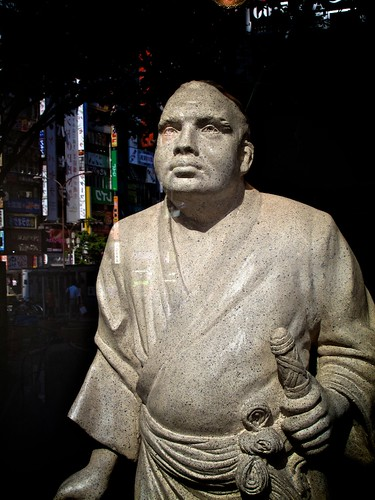 Satsuma Samurai looks upon the lights of modern Shinjuku