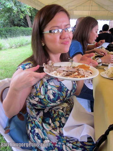 Shen enjoying her plateful of Lechon!