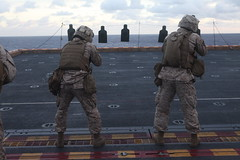 Marines fire upon targets on ship