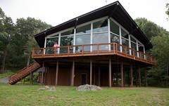 Lauri on balcony of Blue Mountain Lodge