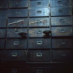 apothecary cabinet (lcy) Tags: travel 6x6 tlr mediumformat slide ishootfilm unesco worldheritagesite squareformat nostalgic e6 melaka malacca 120mm oldshop  rxp vanishingtrade epsonv700 chinesewords dyingtrade mamiyac330f fujichromeprovia400x sekor65mmf35 traditionaltrade malaysia2010