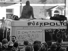 Sitting on the Police van - London students pr...