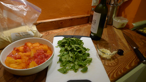 The basic sauce ingredients: tomatoes, arugula, garlic, white wine