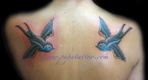 Tatuaje golondrinas Pupa Tattoo Granada. Pupa Tattoo Art Gallery