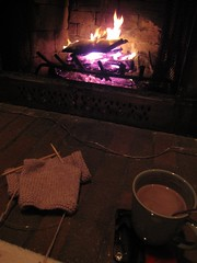 Knitting and hot chocolate in front of the fireplace.