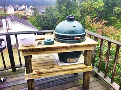 Big Green Egg loaded with two chickens and pork roast. Julie and I made the table. #fb