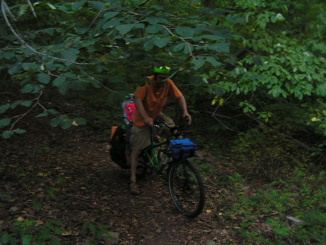 Chris pilots a cargo bike through the woods