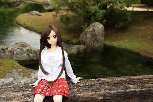 Yoko sitting on a bridge in the Japanese Garden
