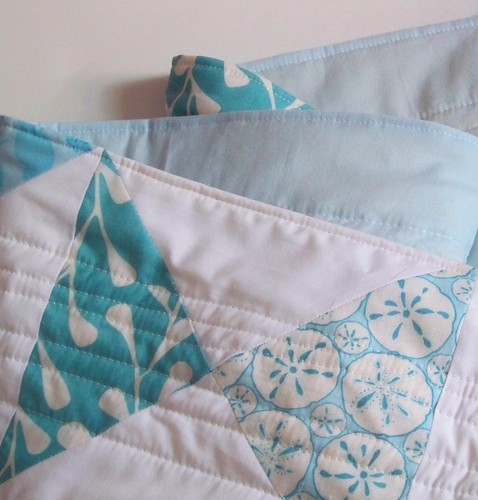 folded turquoise and white modern cottage quited table runner