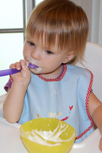 Using the spoon all by herself.