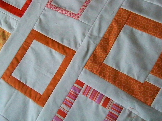 modern quilt top pink orange open boxes on white background
