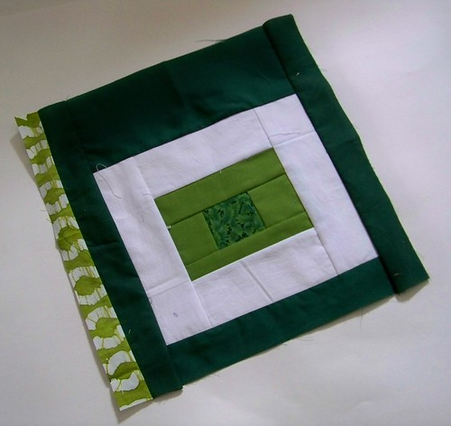 Dark green square in square improv block for rainbow around the block