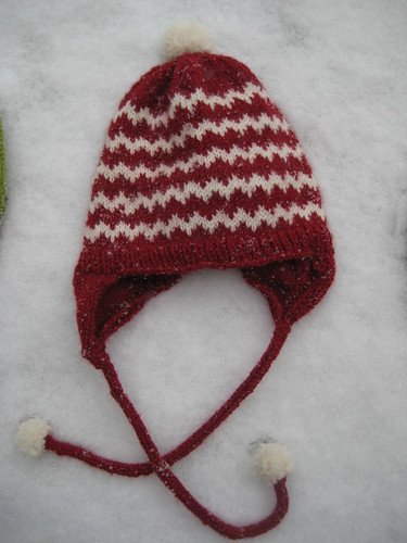 earflap cap with pompoms