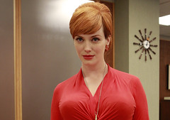 Joan Holloway in tight red blouse - Fashion of...