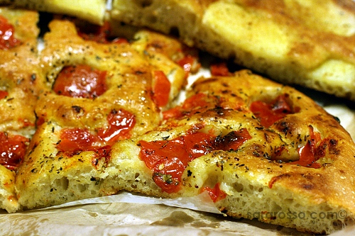 Pizza with fresh tomatoes in Puglia