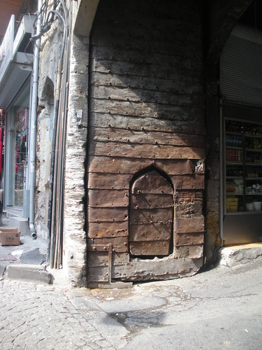 Metal-clad wooden door in shopping precinct