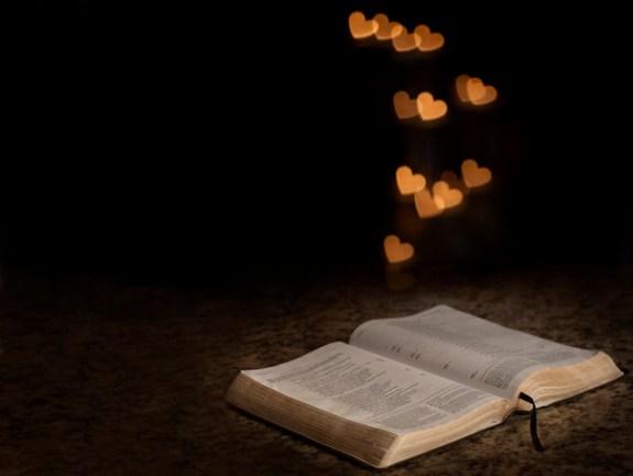 Bible with heart shaped bokeh