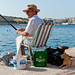 Fisherman and his cat