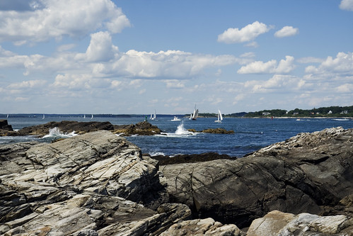 Standing on the rocks, taking pictures of Casco Bay.