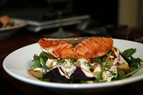 Salmon steak on potato and beetroot salad