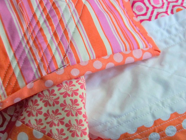 work in progress pink and orange half square triangle modern quilt
