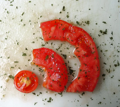 Photo of tomato slices in the shape of the RSS symbol