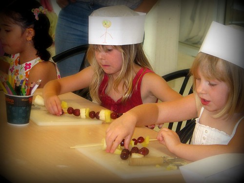 Making Fruit Kebobs at Sierra's Party