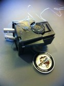 Taser X26 cartridge and coin