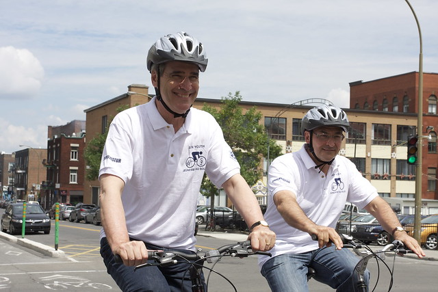 Ignatieff sitting on a bicycle