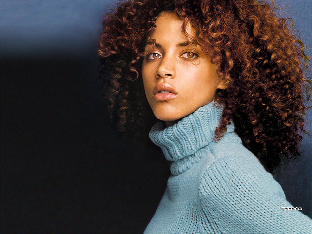 Noemie Lenoir in chunky turtleneck