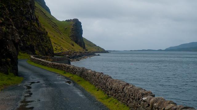 Narrow road beneath the cliffs